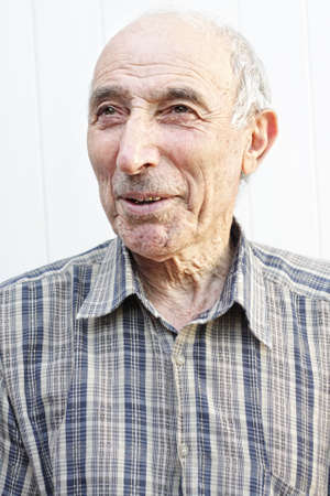 Elderly man looking aside against light background Stock Photo - 5638178