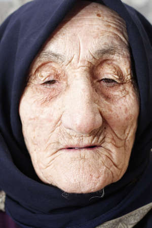 Old woman lost in thoughts closeup face portrait Stock Photo - 5638159