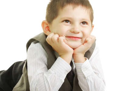 Smiling kid looking up laying down against white background Stock Photo - 5724705
