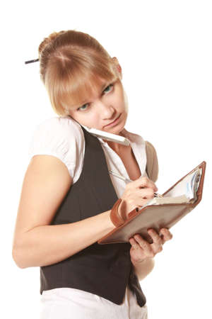 interrupted: Interrupted serious businesswoman with mobile phone and notepad