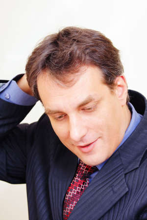 Businessman in formal wear scratching head closeup photo photo