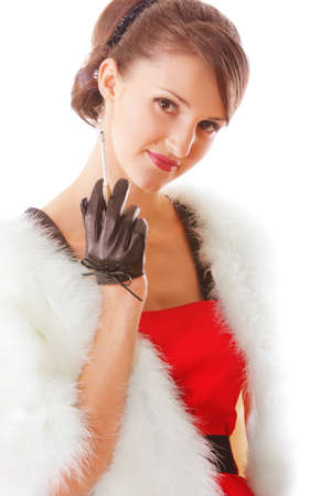 Young woman in red dress with cigarette against white background photo