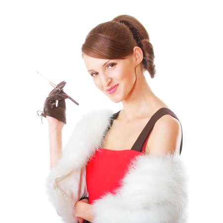 Young elegant woman in fur coat smokes cigarette photo
