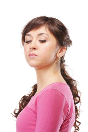 Haughty young brunette woman in pink against white background
