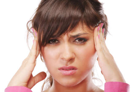 Young brunette woman suffers from headache pressing temples with hands Stock Photo - 5918082