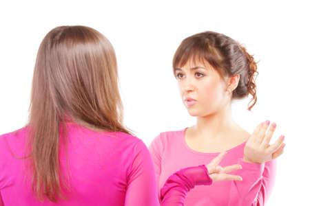 gesticulation: Active gesticulation in women conversation photo against white Stock Photo