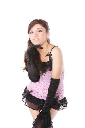 ligueros: Mujer en rosa inclinaci�n hacia adelante sobre fondo blanco
