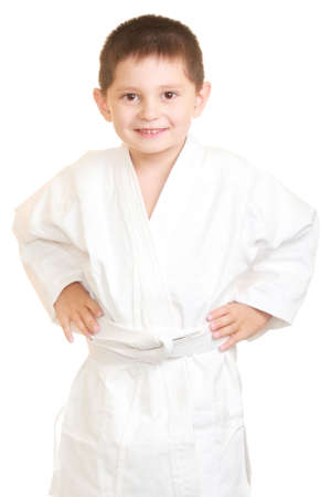 Funny karate kid holding hands on sides photo against white background