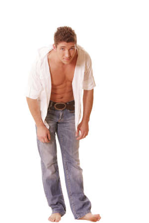 unbuttoned: Guy in unbuttoned shirt and jeans inclines forward