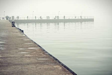 azov sea: Artificial bay in Azov sea at hazy early springtime morning