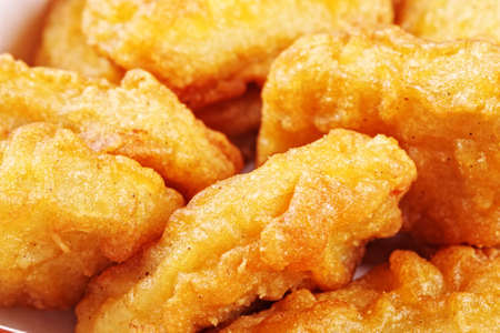 Roasted chicken nuggets closeup photo selective focus Stock Photo