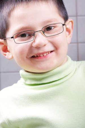 Toothy smiling cute kid in eyeglasses  photo