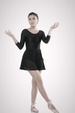 perplexity: Pretty ballerina dancer in perplexity photo against light background