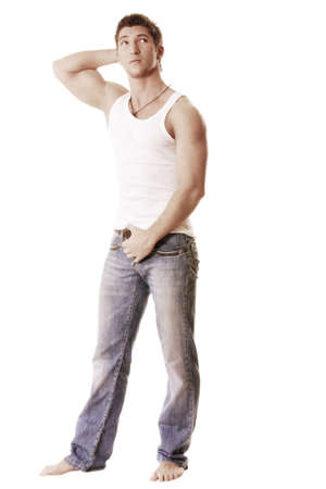 Barefoot guy in sleeveless shirt against white background Stock Photo - 6235376