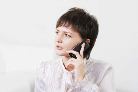 Serious young businesswoman talking on mobile phone Stock Photo - 6286422