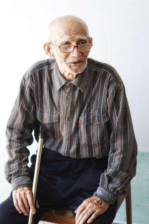 Senior man sitting on chair selective focus on eyes Stock Photo - 6376684