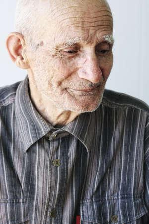 Thoughtful senior man looking down closeup photo Stock Photo - 6376692