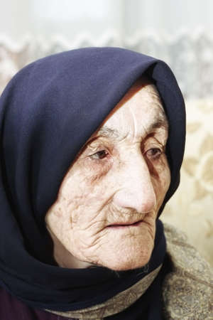 Elderly woman looking aside closeup facial portrait Stock Photo - 6376688