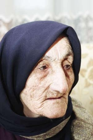 Elderly woman looking aside closeup facial portrait Stock Photo - 6376688