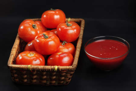 intact: Basket with only intact tomatoes and ketchup in darkness Stock Photo
