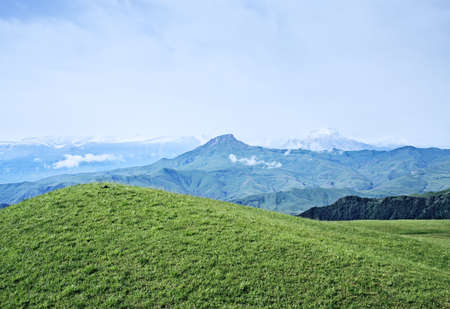 Mountains in summer with snow laying on far peaks Stock Photo - 6423079