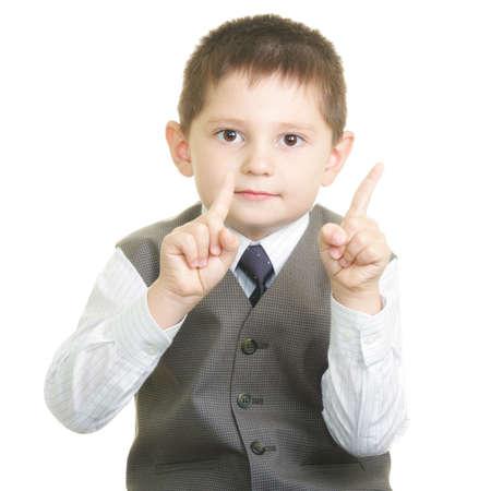 negation: Little cute boy raising forefingers in negation gesture