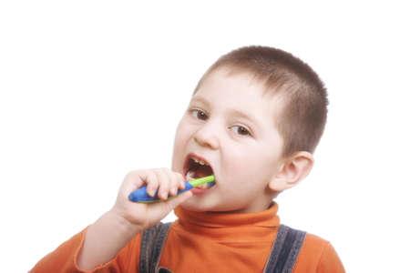 Little kid brushing teeth closeup photo against white