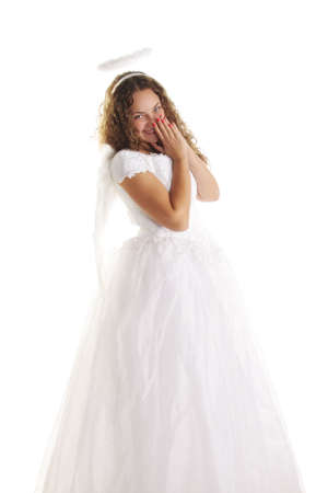Beautiful young woman in white angel dress laughing photo