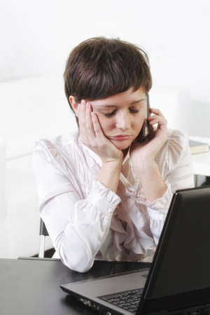 tiresome: Young businesswoman at tiresome phone talk eyes closed