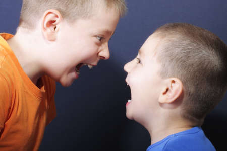 bawl: Jokingly shouting brothers against blue background