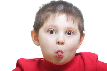 Funny little boy in red showing tongue closeup photo