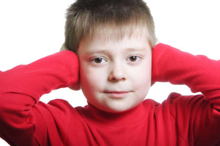 shutting: Boy in red shutting ears with hands photo against white background