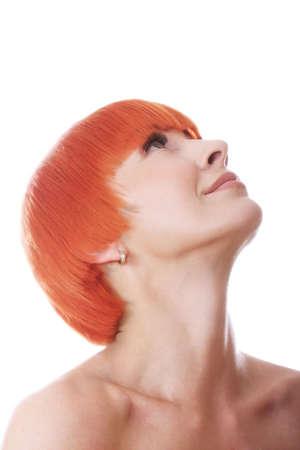 Pretty redhead woman raising eyes closeup photo against white