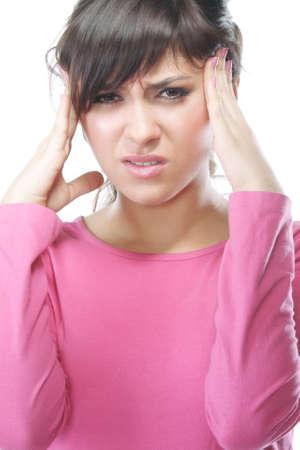 splitting headache: Young brunette woman with splitting headache against white background