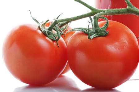 Branch of ripe tomatoes closeup photo against white background