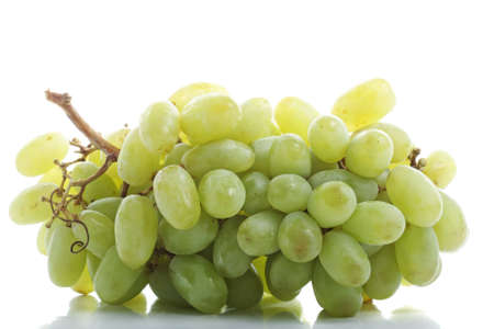 Bunch of green grapes with reflection against white background