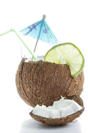lime fruit: Cocktail made of cracked coconut against white background