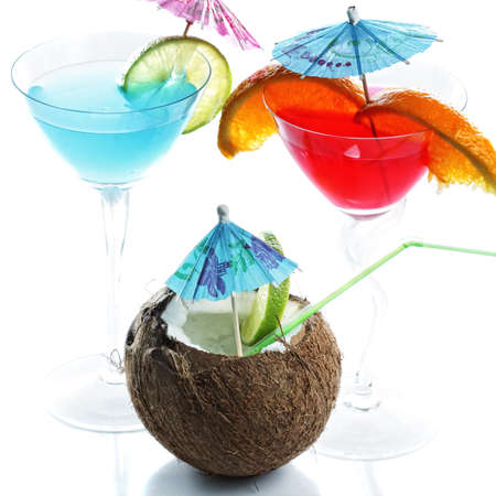 Tree tropical cocktails photo against white background