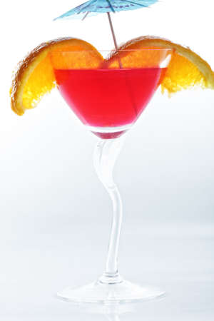 Red tropical cocktail photo against light background Stock Photo - 6982329