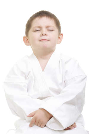 pompous: Pompous little karate kid looking from above photo against white background