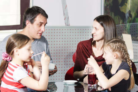 offsprings: Family spending time in cafe at glass table selective focus photo Stock Photo