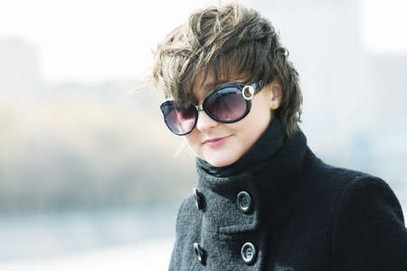 matted: Pretty young woman in sunglasses hair matted by wing