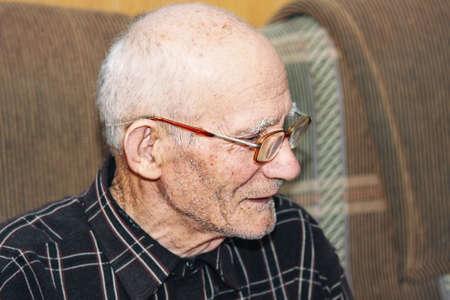 Senior man sitting on sofa sideview photo selective focus Stock Photo - 7257646