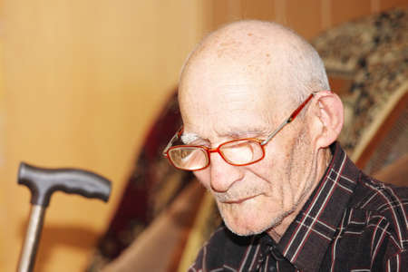 Pensive senior man sitting on sofa closeup photo Stock Photo - 7257642