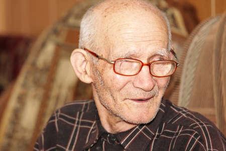 Senior man sitting on sofa indoor closeup photo Stock Photo - 7257638