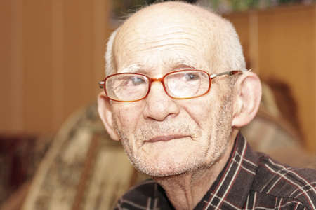 Senior man in eyeglasses looking to camera indoor portrait Stock Photo - 7257637