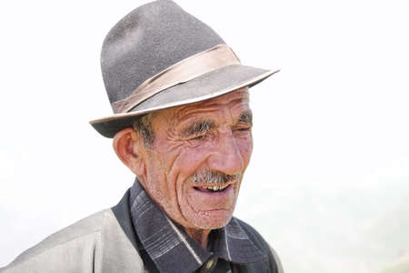 Pensive elderly man in hat closeup outdoors photo Stock Photo - 7533764