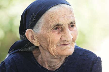 Portrait of thoughtful elderly woman closeup outdoors portrait Stock Photo - 7599255