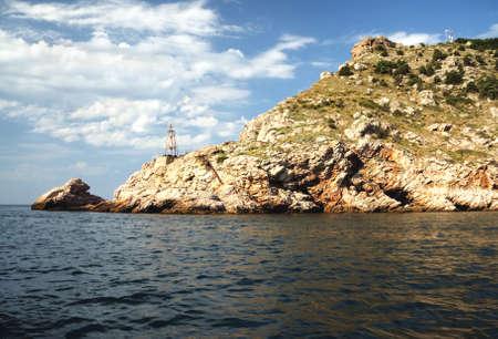 Crimea mountains dipping in Black sea under summer sunlight Stock Photo - 7757195