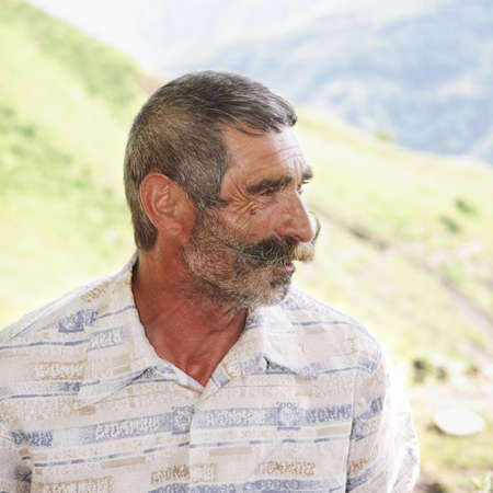 Elderly man with great moustaches profile view outdoors Stock Photo - 7757281